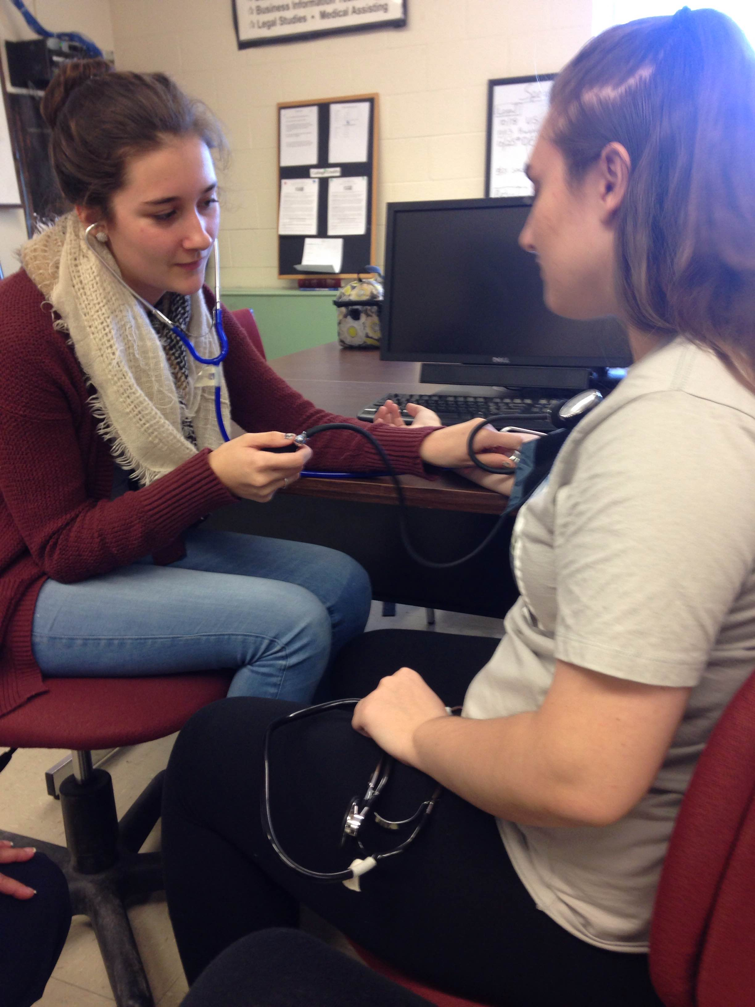medical assisting students practice clinical skills